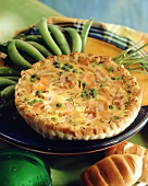 Quiche Lorraine with bacon, peas and cheese