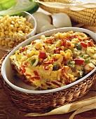 Vegetable casserole with corn in white dish