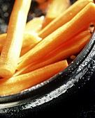 Peeled carrots in a metal dish