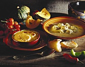 Pumpkin soup with toasted white bread; broth with dumplings