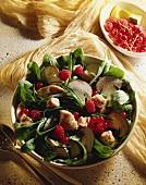 Herb salad with mushrooms, berries and tuna