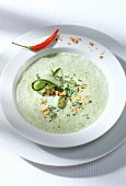 Cream of courgette soup with peanuts and chili