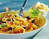 Spaghetti alla puttanesca (with olives, tomatoes & capers)