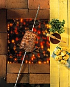 Beef on skewer over glowing charcoal