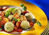 Basil dumplings with mushrooms and tomato & courgette sauce