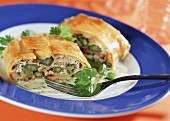 Asparagus strudel with ricotta and coriander leaves