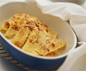 Hearty pancakes with bacon and cheese in baking dish