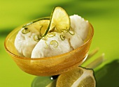 Lemon grass sorbet with lime slices and lime zest