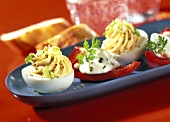 Stuffed eggs and pepper boats with cheese mousse