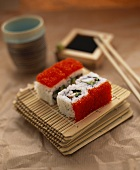 Ura maki (inside out roll) with caviare on bamboo mat