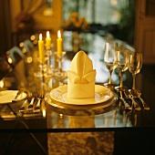 Table setting with stylishly folded napkin