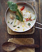 Chicken soup with coconut milk and lemon leaves