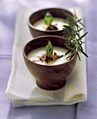 Polenta cream soup with chanterelles and black olives