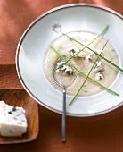 Cream of celery soup with blue cheese and chives