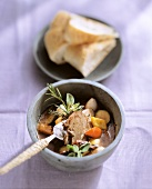 Lamb stew with dried tomatoes, herbs and white bread