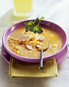 Mango soup with chicken breast and fresh mint