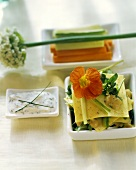 Open lasagne with wild herbs; herb dip; vegetable strips