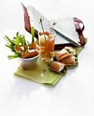 Carrots with Parma ham, melon drink and salmon snacks