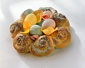 Easter wreath with rose petals and painted eggs