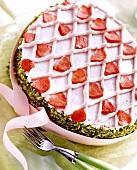 Strawberry sponge egg with pistachio edge & pink bow