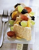 Semolina halva with fresh berries, grapes and pears