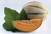 Charentais melon with melon slice and leaf