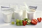 Three jars of yoghurt, two pots of yoghurt & fresh fruit