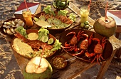 Fish and seafood dishes with drinks on beach
