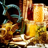 Herrings; bottled vegetables in jars; dried herbs