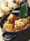 Meat stew with mushrooms and bay leaf