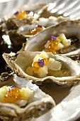 Oysters with apple cubes and caviare