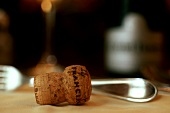 Wine corks in front of a fork on a table