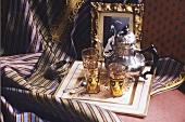 Middle Eastern tea scene with teapot and tea glasses