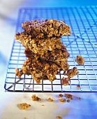 Home-made muesli bars on cake rack