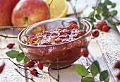 Rosehip and apple preserve in glass bowl