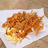 Organic waste on kitchen paper (carrot trimmings, apple peel)