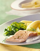 Salmon trout with spinach and boiled potatoes