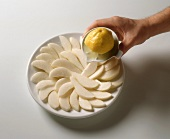 Sprinkling pear slices with lemon juice