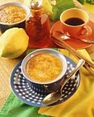 Crème brulee in bowl; cinnamon sticks; coffee cup