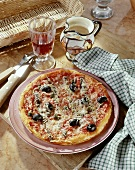Pizza alla marinara (pizza with anchovies, olives, capers)