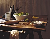 Still life with ingredients for apple cake on wooden table