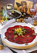 Beef carpaccio with truffles, garnished with herbs
