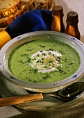 Whipped cress soup with cress leaves and whipped cream