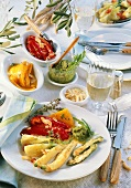 Mediterranean antipasti with almonds, pesto and white wine