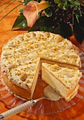 Layered gateau with almonds and praline (a piece cut)