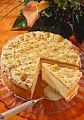 Layered gateau with almonds and praline (a piece cut)
