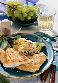 Pike-perch fillet on creamed cabbage with green grapes