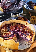 Red cabbage quiche with sausage and bacon