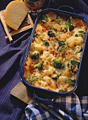 Broccoli & cauliflower bake; Gouda on grater; wine glass