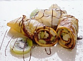 Pancakes with kiwi fruit filling, chocolate sauce & cream